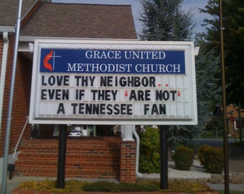Funny church sign - love thy neighbor, even if they are not a Tennessee fan.