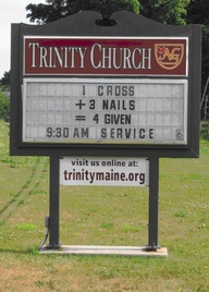 Funny church math on a sign - 1 cross plus 3 nails equals 4 given.
