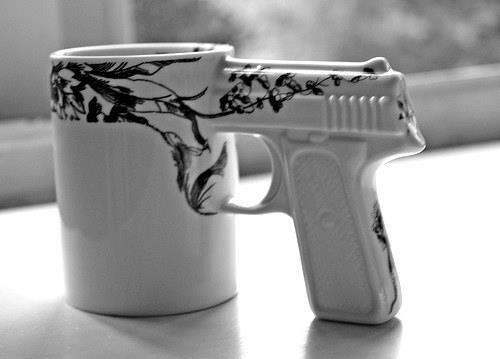 Funny sign of a coofee mug with a revolver handle. http://www.lbsommer-author.yolasite.com/gun-signs.php