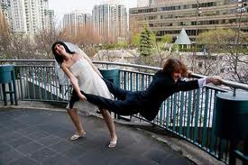 Humorous photo of bride to be trying to drag her groom into the wedding