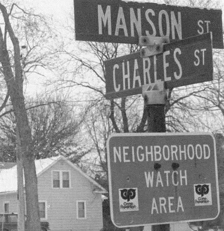 Funny street signs - Charles St intersects with Manson St